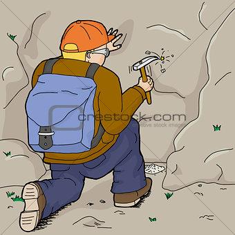 Kneeling Geologist Working Alone