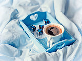Blue Tray with breakfast on a bed