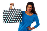 Pretty young model posing with shopping bag