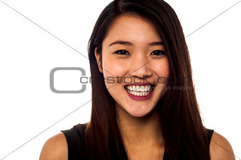 Smiling asian girl with beautiful long hair