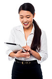 Corporate woman brwosing on tablet pc