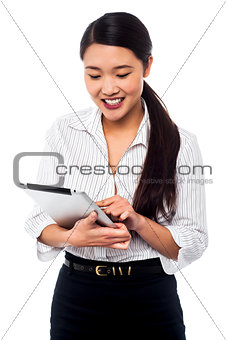 Corporate woman brwosing on tablet pc
