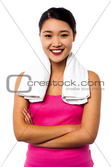 Fit smiling woman with towel around her neck