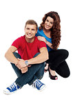 Attractive love couple sitting relaxed on floor