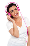 Young smiling woman listening to music
