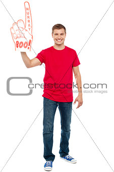 Casual guy showing large pointy boo hurray hand