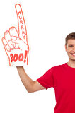 Cropped image of a casual guy with big foam hand