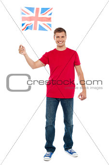 Causal guy waving United Kingdom flag