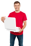 Smiling casual man holding pizza box