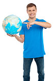 Smart guy pointing at the globe. Dressed in casuals