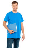 Smiling guy holding spiral notebook