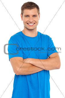 Casual portrait of smiling man posing with arms crossed