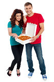 Young couple about to enjoy pizza together