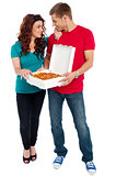 Love couple sharing pizza. Enjoying together