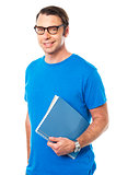 Casual young guy holding notepad