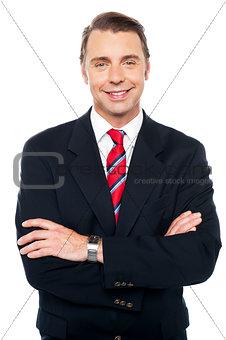 Arms crossed portrait of caucasian businessman