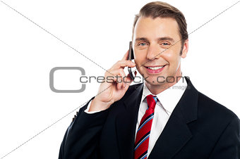 Corporate male consultant talking over cellphone