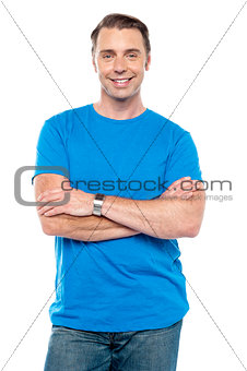 Smart young guy posing with arms crossed
