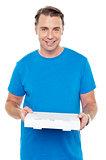 Hungry man holding pizza box