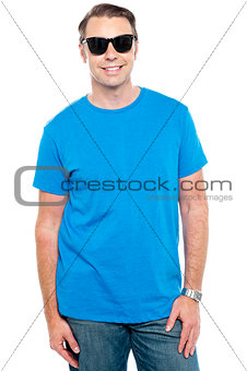 Casual stylish portrait of guy wearing sunglasses