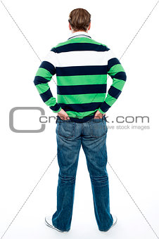 Back pose of man posing with hands in pocket