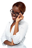 African female executive adjusting her spectacle