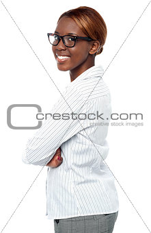 African business executive smiling with crossed arms