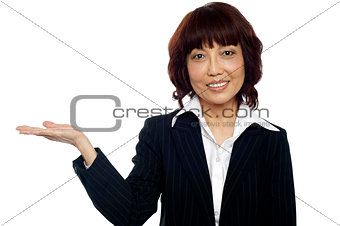 Smiling asian female presenting copy space