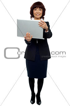 Business representative holding laptop