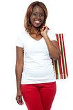 Shopper woman posing with shopping bag