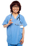 Experienced female pediatrician ready with a syringe