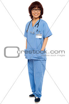 Asian surgeon posing with hands in her uniform