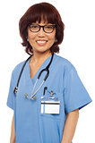 Pleasing female gynecologist posing with stethoscope