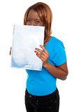Pretty girl hiding her face through notebook