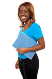 Smiling african college girl carrying her assignment