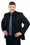 Confident young businessman posing casually