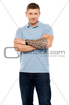 Casual man with artistic tattoo drawn on hand