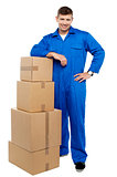 Relocation staff member resting against stack of cartons