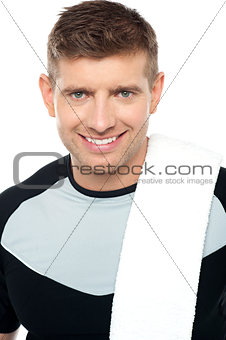 Close up shot of smiling male in sportswear