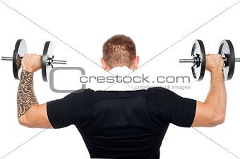 Back pose of male bodybuilder lifting weights