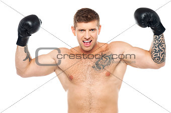 Attractive young boxer posing strongly