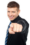 Joyous business consultant pointing at you