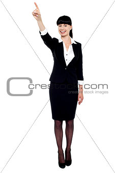 Business lady pointing her finger upwards