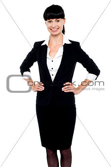 Smartly dressed woman with hands on her waist