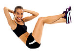 Fit woman in sporty attire doing crunches