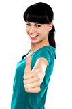 Attractive woman showing thumbs up gesture