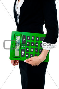 Cropped image of a woman holding big calculator
