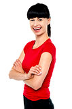 Pretty slim lady in bright red top, arms folded