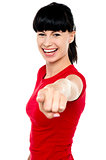 Attractive cheerful woman pointing at you