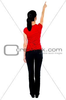 Back pose of woman in casuals pointing away